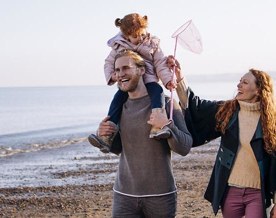 Family out on beach with dog