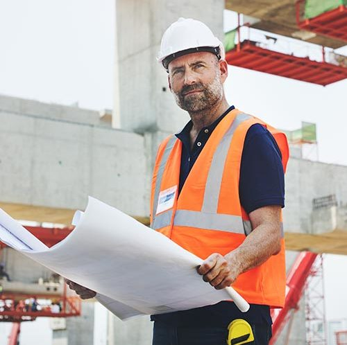 Builder on site looking pensive